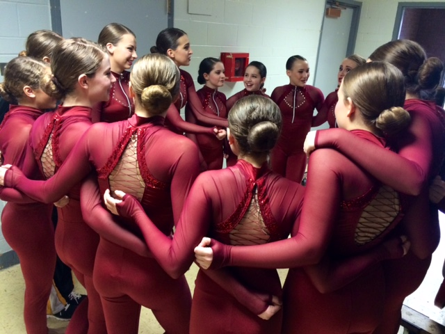 Hinsdale South's dancers know that pre-performance circles lead to championship kick lines